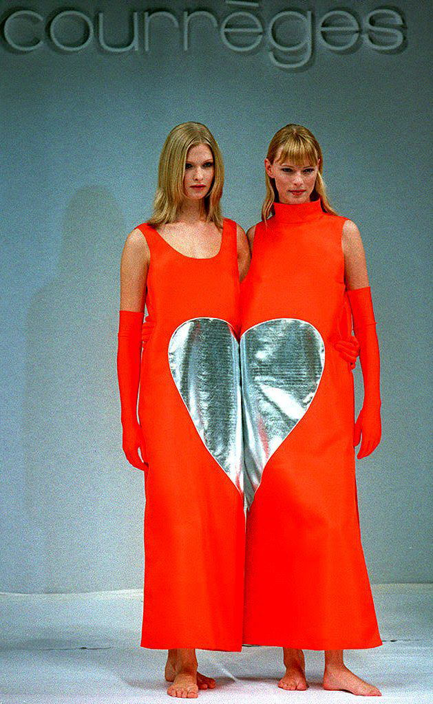 Two models present French fashion designer Courreges