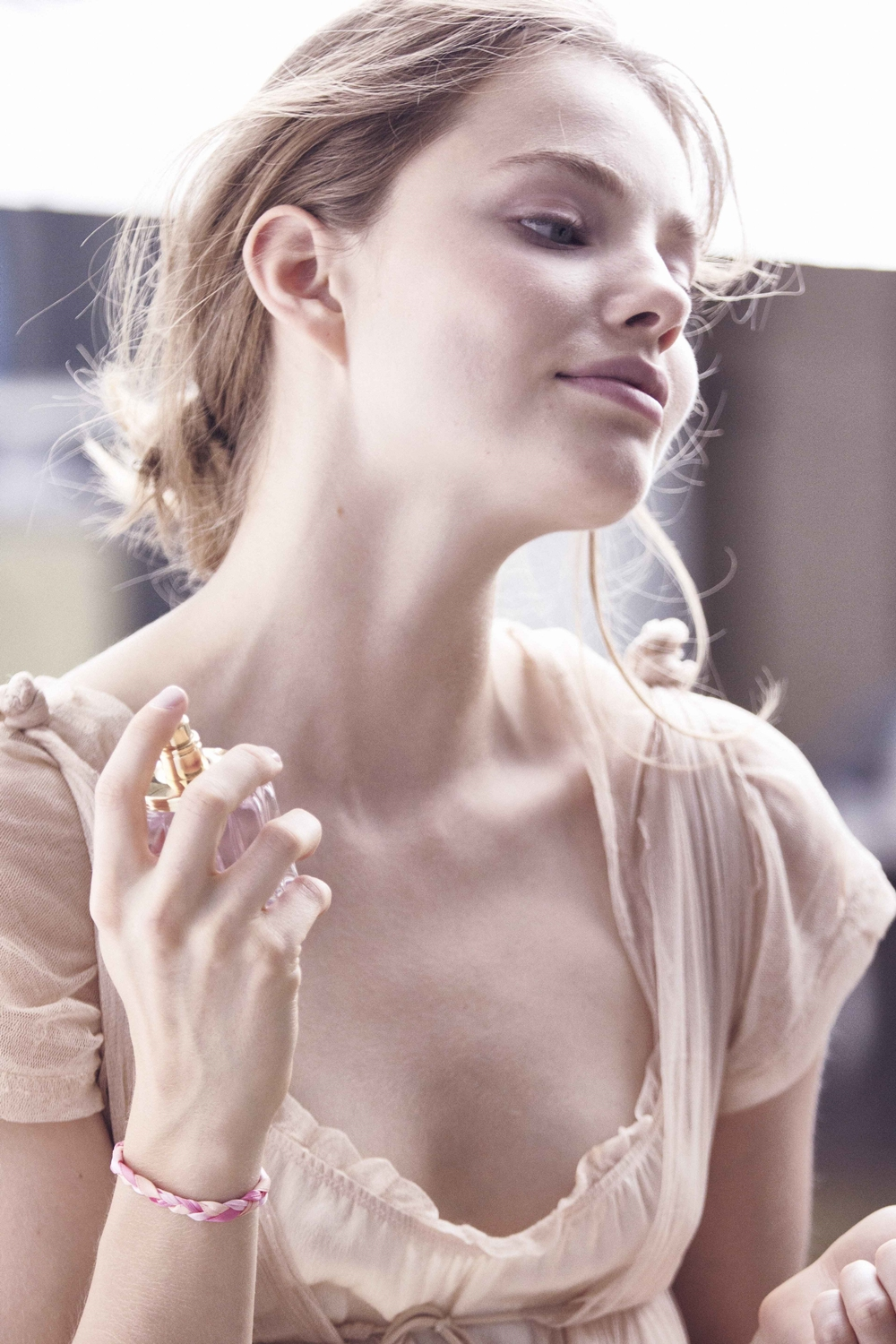 Flora Chic Behind the Scenes image - woman spraying fragrance on her neck
